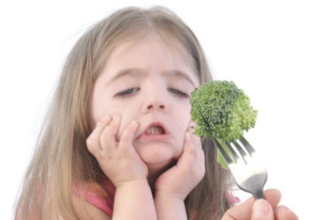 Girl Dreading Broccoli