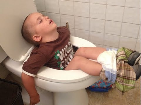 Boy Sleeping In Toilet